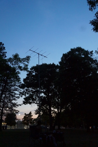 No, we're not stealing WiFi or looking for UFOs; we use this giant antenna to tune into our radio-tagged bats. The antenna is attached to a radio receiver, similar to what you have in your car. We can then tune into the radio channel of our bat.